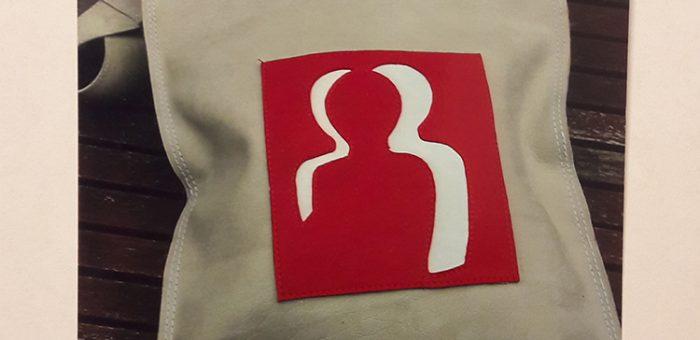 Tas + logo